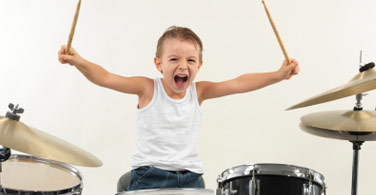 young boy playing the drums