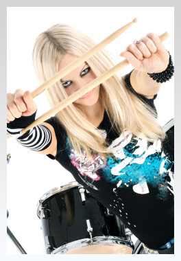 girl looking inbetween drumsticks